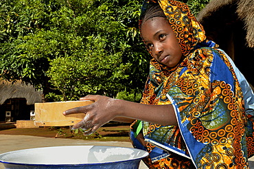Young girl in the village of Idool sifting flour, near Ngaoundéré, Cameroon, Central Africa, Africa