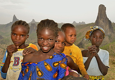 Children in front of the volcanic landscape at the village of Rhumsiki, Mandara Mountains, Cameroon, Central Africa, Africa