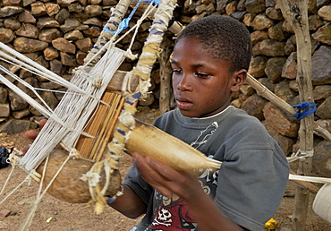 Boy working on a loom in the village of Rhumsiki, Cameroon, Central Africa, Africa