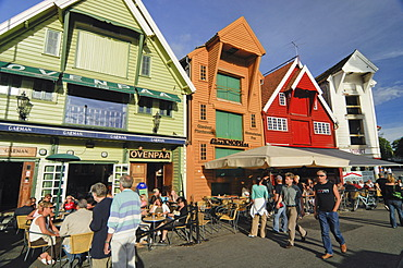 Tourists sitting outside a restaurant in the picturesque old town of Stavanger, Rogaland, Norway, Scandinavia, Europe