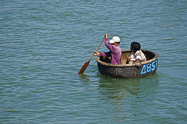 Traditional round wicker boat on the Cai river in the port, Nha Trang, Vietnam, Southeast Asia
