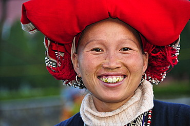 Woman from the Red Dzao ethnic minority group, a mountain tribe, at the market of Sapa or Sa Pa, northern Vietnam, Vietnam, Asia
