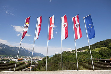 """Flags on the forecourt of the """"Tirol Panorama"""" Museum at Bergisel, Innsbruck, Tyrol, Austria, Europe"""