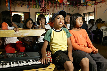 Indian children sitting next to an e-piano, Loma Plata, Chaco, Paraguay, South America