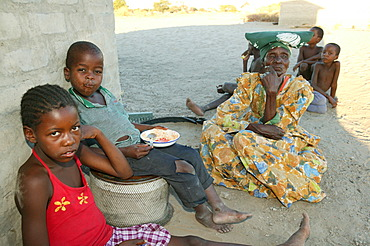 Grandmother with grandchildren, Sehitwa, Botswana, Africa