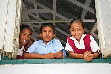 Pupils in uniform during break, Amerindians, tribe of the Arawak, Santa Mission, Guyana, South America