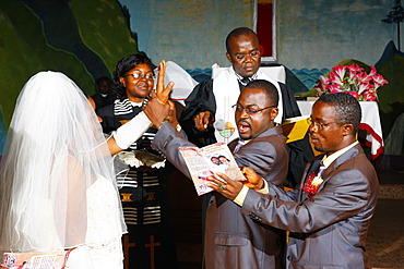 Bride and groom taking their wedding vows, Bamenda, Cameroon, Africa