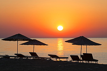 Beach chairs and sunshades on the beach at sunrise, Lycian coast, Lycia, the Aegean, Mediterranean Sea, Turkey, Asia Minor
