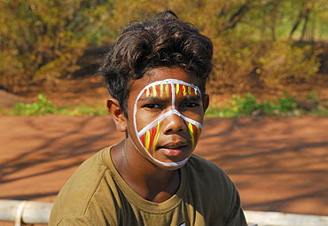 Aboriginal boy posing for tourists, Tiwi Islands, Darwin, Northern Territory, Australia