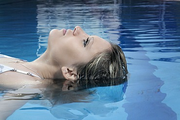 Young dark-blond woman swimming
