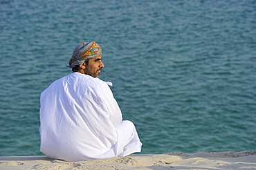 Arab in front of Khor Al Udeid Beach, Khor El Deid, Inland Sea, desert miracle of Qatar, Emirate of Qatar, Persian Gulf, Middle East, Asia