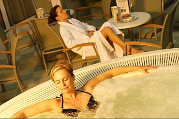 Whirlpool, two young women relaxing