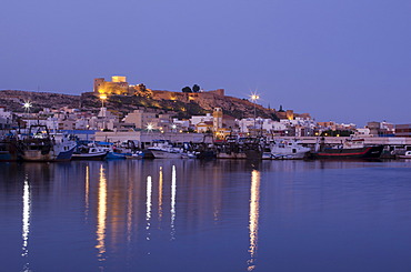 View fo the harbour of Almeria and Alcazaba at dusk, Andalusia, Spain, Europe