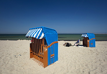 Roofed wicker beach chairs on the beach, Zingst peninsula, Mecklenburg-Western Pomerania, Germany, Europe