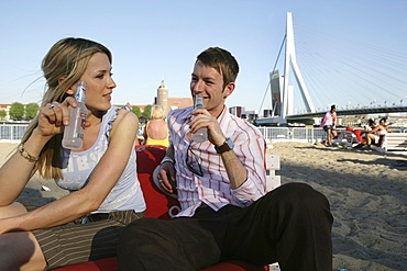 NLD Netherlands Rotterdam: Summer beach club at the Nieuwe Maas river Erasmusbrug bridge. |