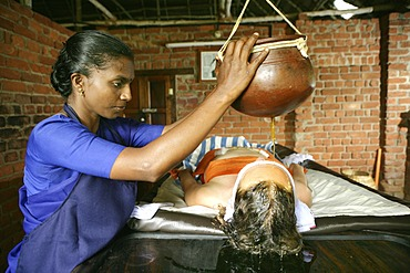 Shirodhara, gently pouring oils over the forehead (the \'third eye\'), Somatheeram Ayurveda Resort, traditional Ayurvedic medicine spa resort in Trivandrum, Kerala, India, Asia