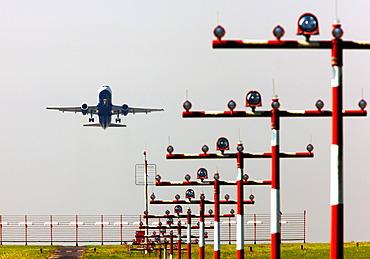 Runway landing lights in front of a British Airways Airbus A320 taking off at Duesseldorf International Airport, Duesseldorf, North Rhine-Westphalia, Germany, Europe