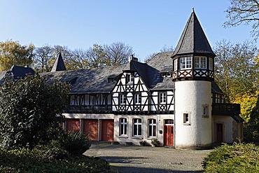 Schloss Eller castle, half-timbered building and tower in the husbandry yard, Duesseldorf, North Rhine-Westphalia, Germany, Europe