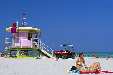 Girls in front of a lifeguard tower at South Beach, Miami Beach, Miami, Florida, USA