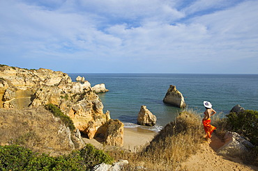 Woman with a view to Paria dos Tres Irmaos, Algarve, Portugal, Europe