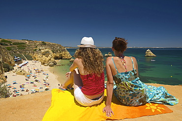 Two women on the beach, Praia Dona Ana in Lagos, Algarve, Portugal, Europe
