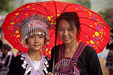 Two traditionally dressed Hmong women at a new year festival at Hung Saew village, Chiang Mai, Thailand, Asia