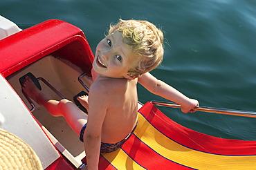 5 year old boy on pedal boat - Lake Wolfgang - Salzburger Land - Salzkammergut - Austria