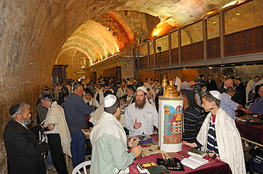 Bar Mitzvah, Jewish coming of age ritual, decorated Torah scroll on table with young man celebrating his Bar Mitzvah, Haftarah, underground part of the Western Wall or Wailing Wall, Old City of Jerusalem, Arab Quarter, Israel, Middle East