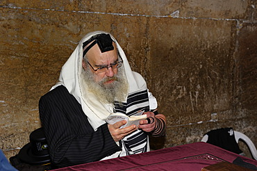Praying Jew in the underground part of the Western Wall or Wailing Wall, Old City of Jerusalem, Arab Quarter, Jerusalem, Israel, Middle East