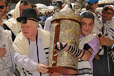 Bar Mitzvah celebration at the Western or Wailing Wall in the direction of the Jewish Quarter, boy is carrying the Torah scroll with the help of his father, Muslim Quarter, Old City, Jerusalem, Israel, Middle East