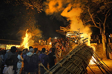 12 meters large bamboo torches are lit at the Shinto shrine at the Autumn Matsuri, religious festival, Iwakura in Kyoto, Japan, Asia