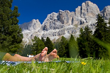 Rest on a mountain walk, hiker relaxing on a meadow, province of Bolzano-Bozen, Italy, Europe