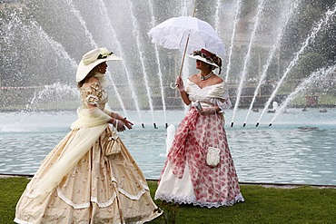 Two women wearing historical costumes in front of a fountain, Rákóczi-Fest festival, Bad Kissingen, Rhoen, Lower Franconia, Bavaria, Germany, Europe