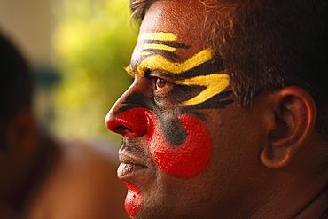 Kathakali dancer with half-finished make up, Chuvanna Thaadi mask, Kerala, southern India, Asia