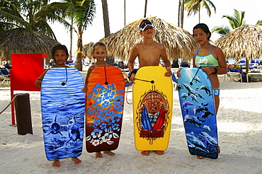 Children with their surfboards on the beach in Punta Cana, Dominican Republic, Caribbean, Americas