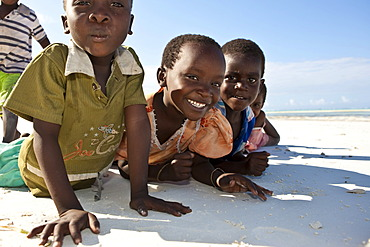 A group of children on the beach at Pingwe, Zanzibar, Tanzania, Africa