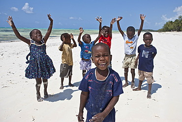 Children playing on the beach, Zanzibar, Tanzania, Africa