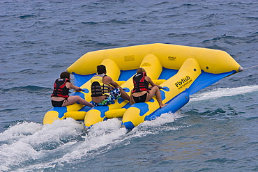 Young people on a fun boat off the beach of the Promenade des Anglais in Nice, Côte d\'Azur, Southern France, France, Europe