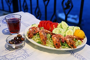 Shrimps and salad, olives and red wine, Crete, Greece