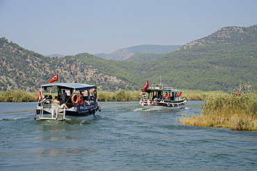 Excursion boats on a river, river delta in the nature preservation area between Caunos and Iztuzu Beach, Dalyan, Mugla Province, Turkey, Asia Minor