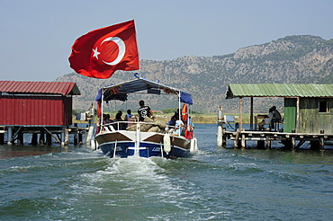 Excursion boat passing a fishnet sluice for regulating the fish stock in a river, river delta in the nature preservation area between Caunos and Iztuzu Beach, Dalyan, Mugla Province, Turkey, Asia Minor