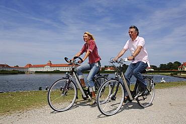 Best Agers, bicyclists, bike tour, Nymphenburg Palace, Munich, Bavaria, Germany, Europe