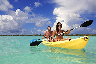 Tourist couple in a kayak, St. Regis Bora Bora Resort, Bora Bora, Leeward Islands, Society Islands, French Polynesia, Pacific Ocean