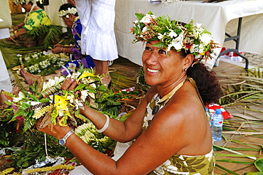 Tahitian woman at a lei, floral garland binding competition, Papeete, Tahiti, Society Islands, French Polynesia, Pacific Ocean