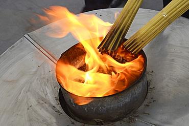 Incense sticks being lit, Shanghai, China, Asia