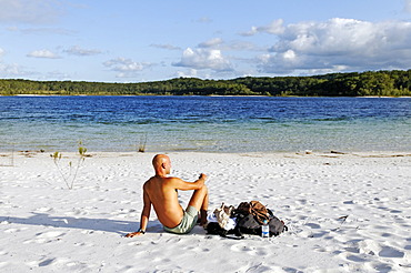 Man on the beach at Lake McKenzie, Fraser Island, Queensland, Australia