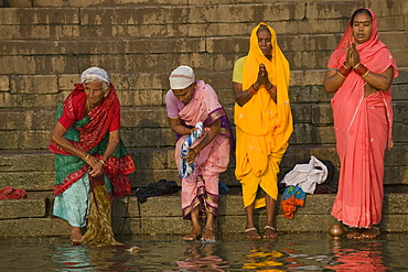 Women at the Hindu morning prayer Puja, Ganges river, Varanasi, Uttar Pradesh, India, Asia