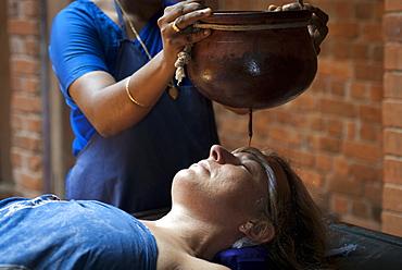Shirodhara, Ayurvedic treatment, oil is gently poured over the forehead, Somatheeram Ayurvedic Health Resort, Chowara, Malabar Coast, South India, India, Asia