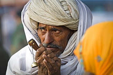 Man wearing a white turban with a chilam pipe, portrait, Jaipur, Rajasthan, India, Asia