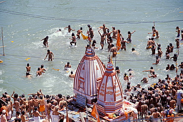 Naked Naga-Sadhus taking a holy bath during the Kumbha or Kumbh Mela in the Ganges River, Har Ki Pauri-Ghat, a famous bathing ghat at Haridwar or Hardwar, Uttarakhand, formerly Uttaranchal, North India, India, Asia